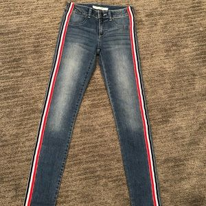 Skinny jeans with red and white stripes